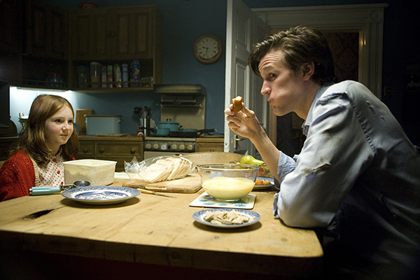 Doctor Who (Matt Smith) eating fish fingers and custard with the young Amelia (Amy) Pond (Caitlin Blackwood)
