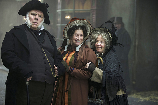 Mr Bumble (Richard Ridings) with Mrs. Bumble (Caroline Quentin) and Mrs Gamp (Pauline Collins) looking to adrian rogeres's camera