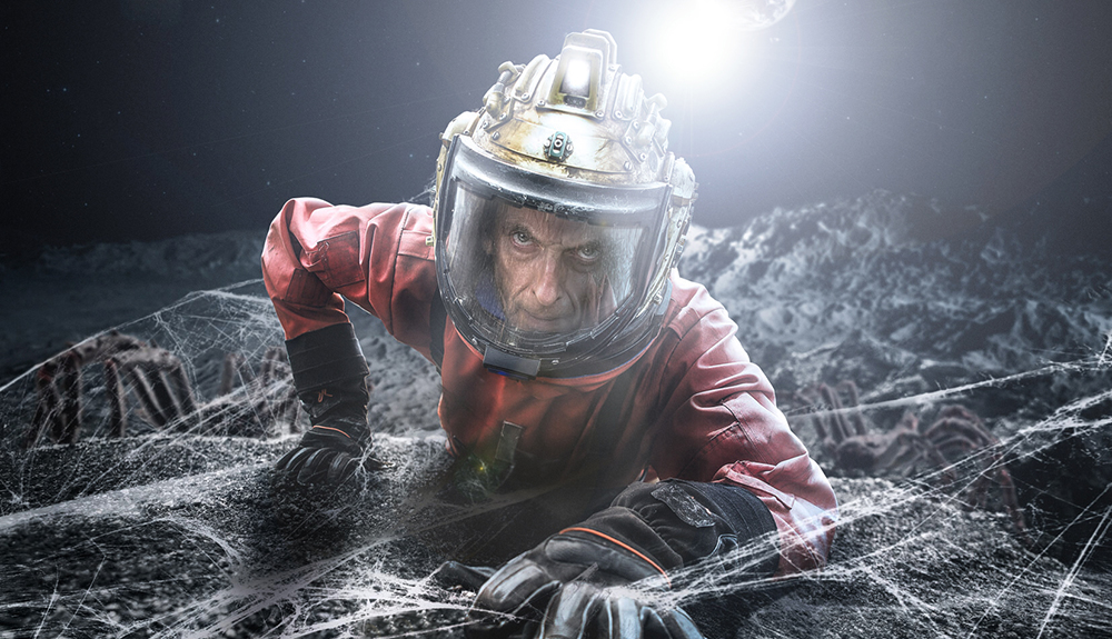 The Doctor (Peter Capaldi) in red space suit crawling,episode Kill The Moon