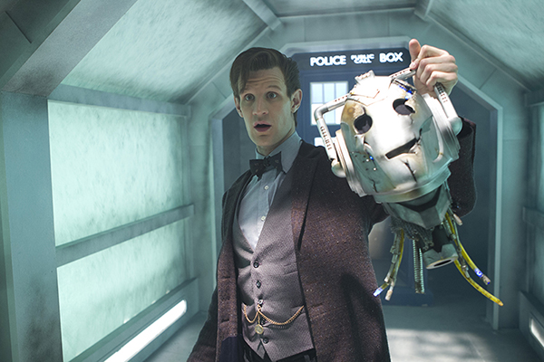 The Doctor (Matt Smith) holds up Cyberman head