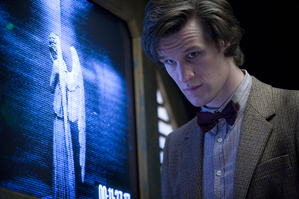 The Doctor (Matt Smith) stands by monitor with angel on it