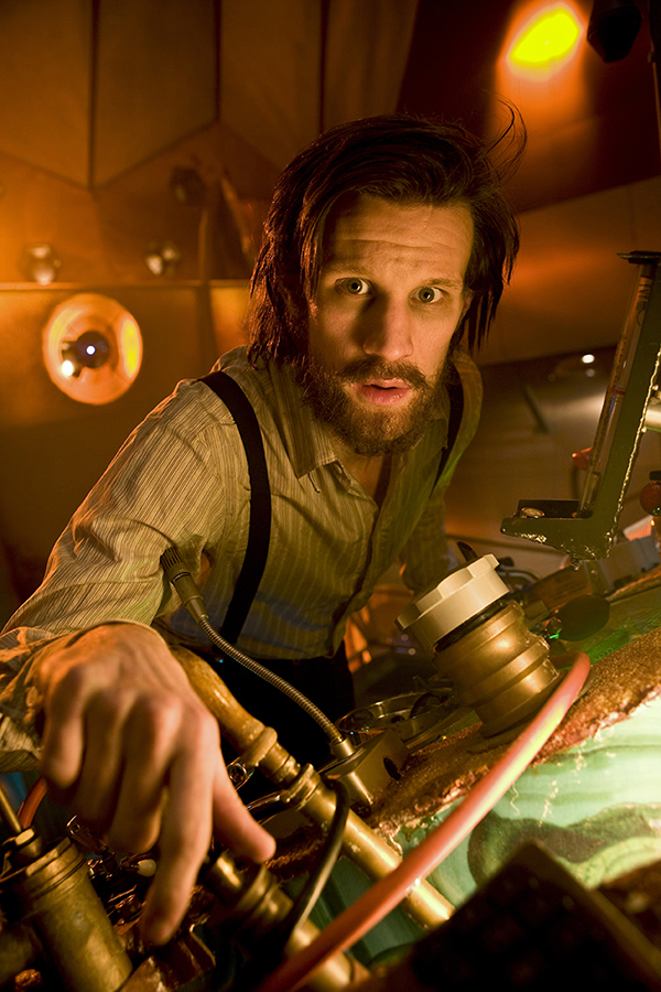 The Doctor (Matt Smith) at the Tardis controls with beard