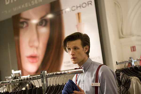 production still photo of The Doctor in a clothes shop