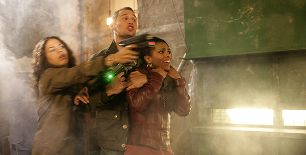 production unit still of Martha being kiddnapped by Milo and Cheen from Doctor Who episode Gridlock