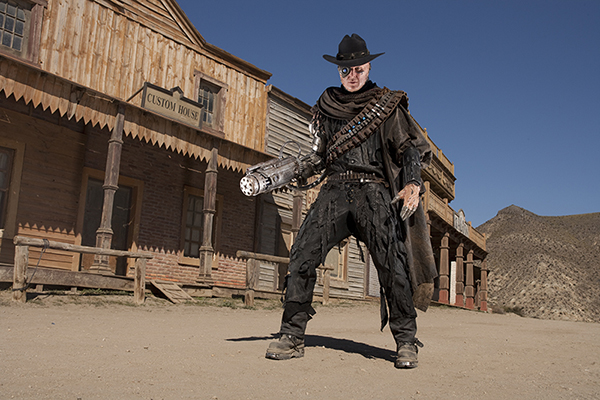 film still of The Gunslinger (Andrew Brooke) standing in street of western town from Doctor Who episode A Town Called Mercy