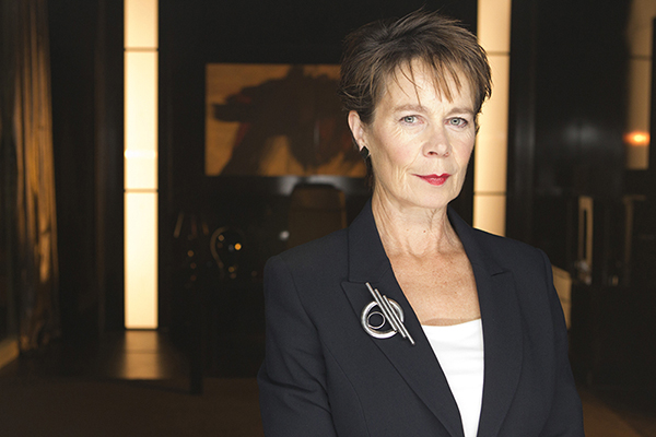 film still photo of Celia Imrie looking into camera as Miss Kizlet from Dr Who episode The Bells of Saint John
