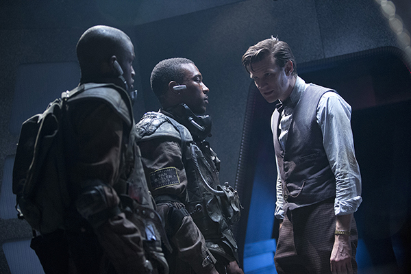 film still of The Doctor, Tricky and Gregor in a Tardis corridor from the Doctor Who episode Journey to the Center of the Tardis