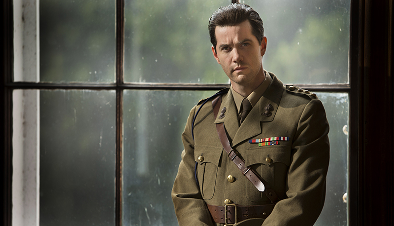 Callum Ferguson (Jim Sturgess) in uniform standing by window