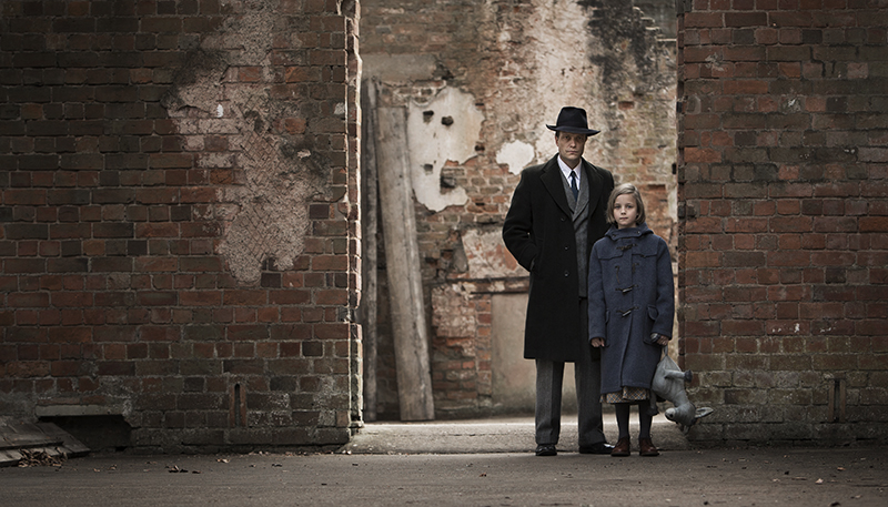 Dieter & Lotte (August Diehl & Lucy Ward) stand together in bomb site
