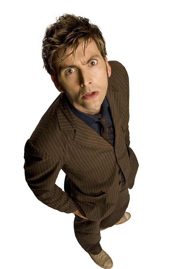 David Tennant as The Doctor wearing brown suit