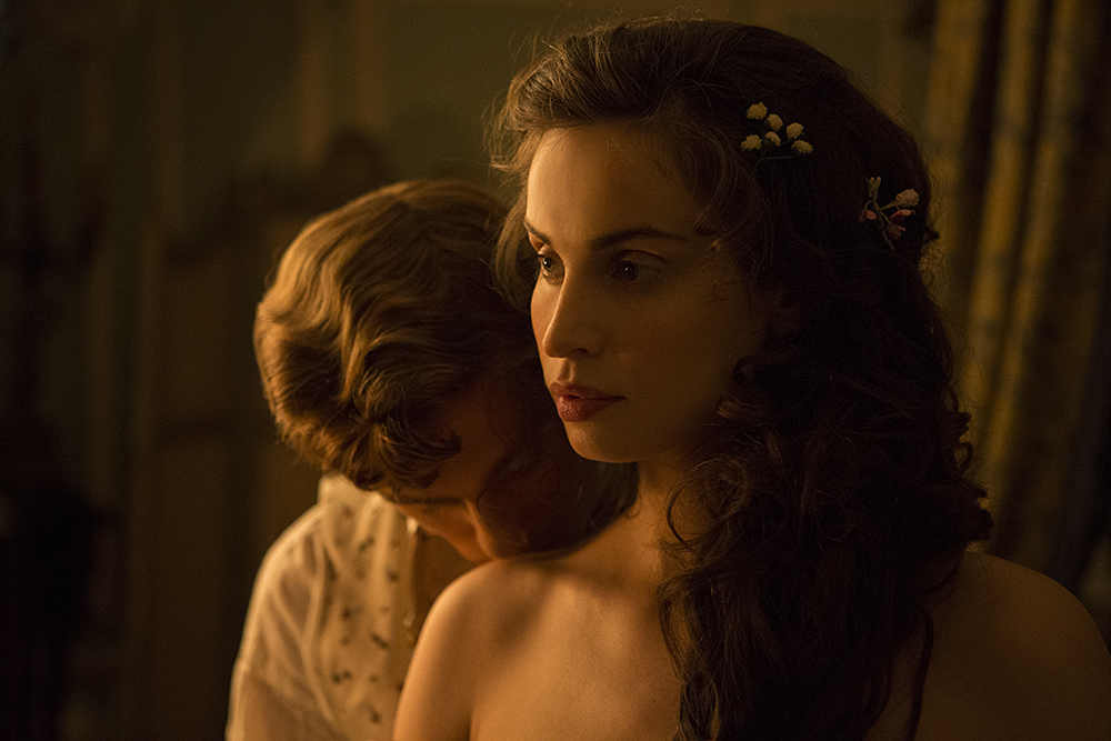 George Warleggan (Jack Farthing) & Elizabeth (Heida Reed), in bedroom, George kisses Elizabeth's shoulder