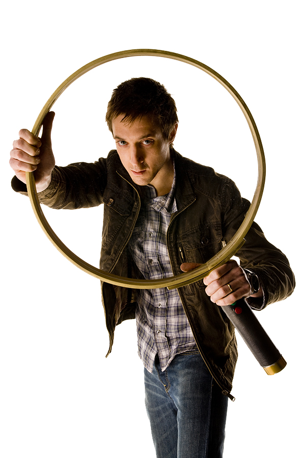 special stills photograph of Arthur Darvill as Rory looking through a magnifying glass from the Doctor Who episode The Girl Who Waited